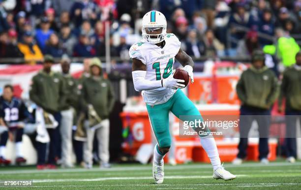 Jarvis Landry of the Miami Dolphins carries the ball during the second quarter of a game against the New England Patriots at Gillette Stadium on...