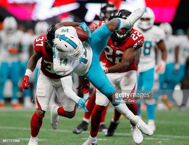 Jarvis Landry of the Miami Dolphins is tackled after pulling in this reception against Ricardo Allen of the Atlanta Falcons at MercedesBenz Stadium...