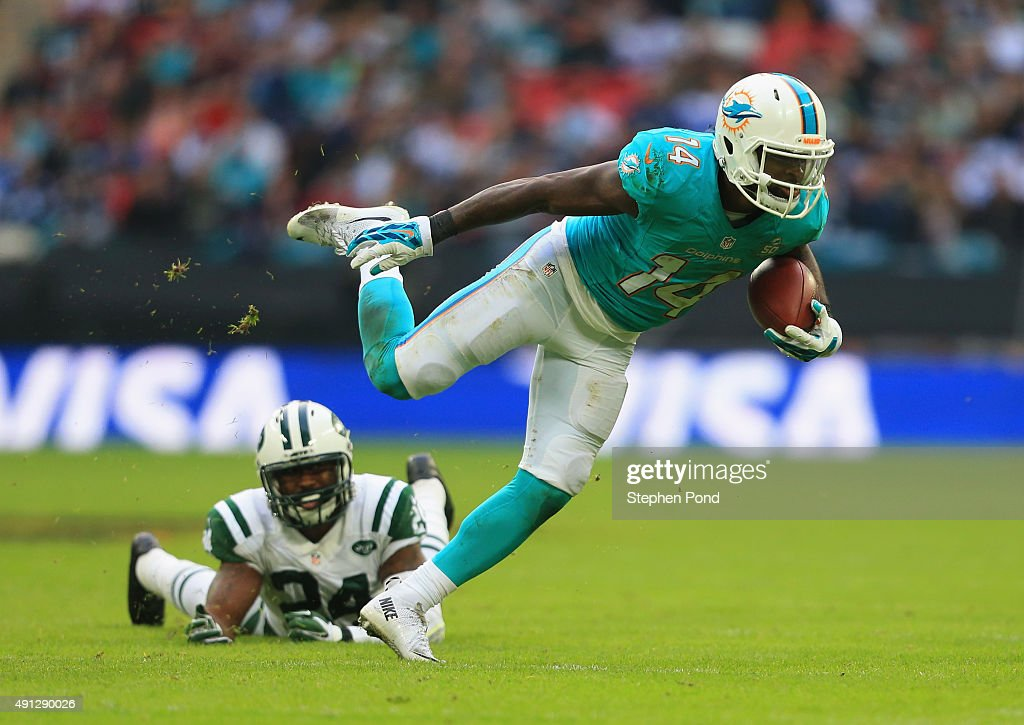 Jarvis Landry #14 of the Miami Dolphins is tackled by Darrelle Revis #24 of the New York Jets during the game at Wembley Stadium on October 4, 2015 in London, England.