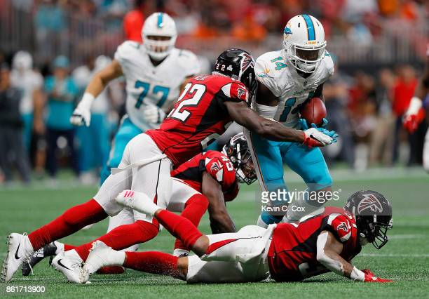 Jarvis Landry of the Miami Dolphins is tackled by Keanu Neal of the Atlanta Falcons after breaking away from Deion Jones and Ricardo Allen at...