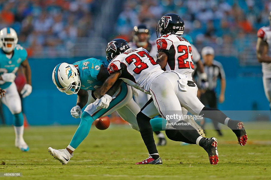 <a gi-track='captionPersonalityLinkClicked' href=/galleries/search?phrase=Jarvis+Landry&family=editorial&specificpeople=8262033 ng-click='$event.stopPropagation()'>Jarvis Landry</a> #14 of the Miami Dolphins is unable to catch the pass while being defended by <a gi-track='captionPersonalityLinkClicked' href=/galleries/search?phrase=Ricardo+Allen&family=editorial&specificpeople=7172781 ng-click='$event.stopPropagation()'>Ricardo Allen</a> #37 and <a gi-track='captionPersonalityLinkClicked' href=/galleries/search?phrase=Robert+Alford&family=editorial&specificpeople=6315945 ng-click='$event.stopPropagation()'>Robert Alford</a> #23 of the Atlanta Falcons during a preseason game on August 29, 2015 at Sun Life Stadium in Miami Gardens, Florida. The Dolphins defeated the Falcons 13-9.