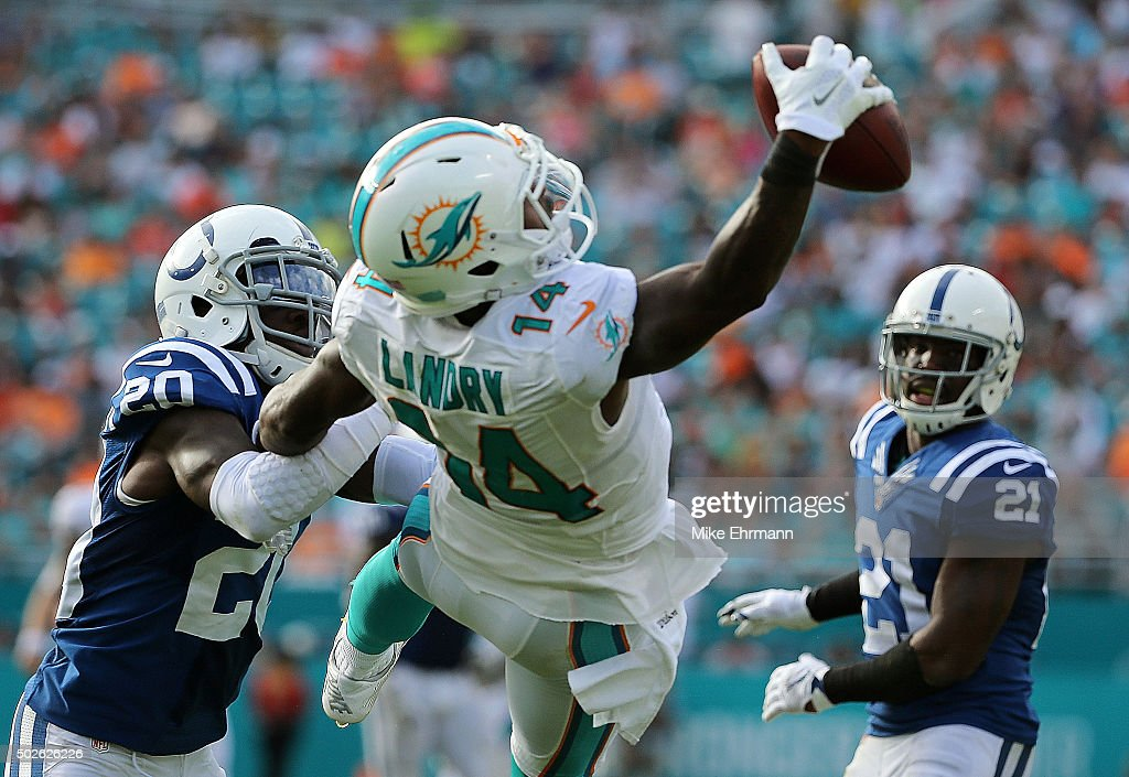 Jarvis Landry #14 of the Miami Dolphins makes a one handed catch during a game against the Indianapolis Colts at Sun Life Stadium on December 27, 2015 in Miami Gardens, Florida.