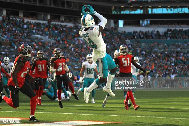 Jarvis Landry of the Miami Dolphins makes the catch for a touchdown during the first quarter against the Tampa Bay Buccaneers at Hard Rock Stadium on...