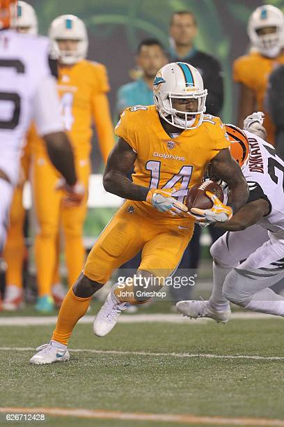 Jarvis Landry of the Miami Dolphins runs the football upfield during the game against the Cincinnati Bengals at Paul Brown Stadium on September 29...