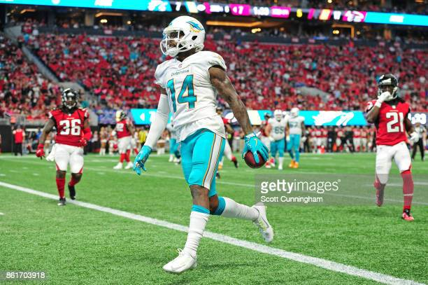 Jarvis Landry of the Miami Dolphins scores a secondhalf touchdown against the Atlanta Falcons at MercedesBenz Stadium on October 15 2017 in Atlanta...