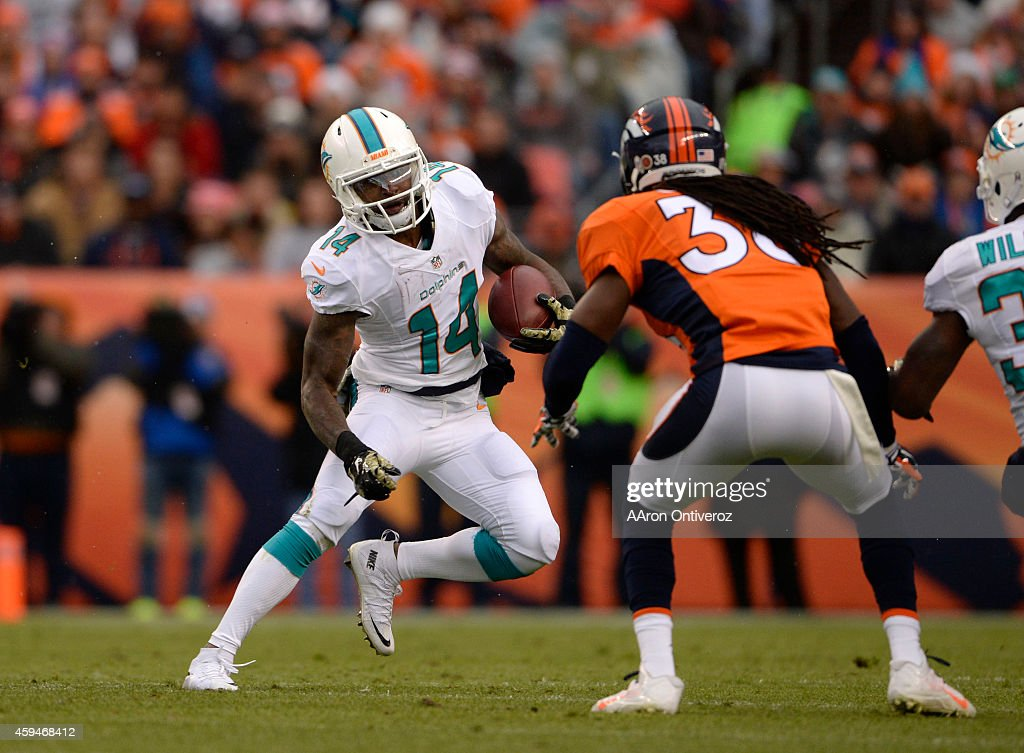 <a gi-track='captionPersonalityLinkClicked' href=/galleries/search?phrase=Jarvis+Landry&family=editorial&specificpeople=8262033 ng-click='$event.stopPropagation()'>Jarvis Landry</a> (14) of the Miami Dolphins tries to get around <a gi-track='captionPersonalityLinkClicked' href=/galleries/search?phrase=Quinton+Carter&family=editorial&specificpeople=5631827 ng-click='$event.stopPropagation()'>Quinton Carter</a> (38) of the Denver Broncos on a punt returnThe Denver Broncos played the Miami Dolphins at Sports Authority Field at Mile High in Denver on November 23, 2014.