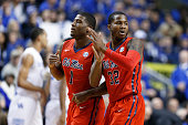 Jarvis Summers and Martavious Newby of the Mississippi Rebels celebrate against the Kentucky Wildcats in the first half of the game at Rupp Arena on...
