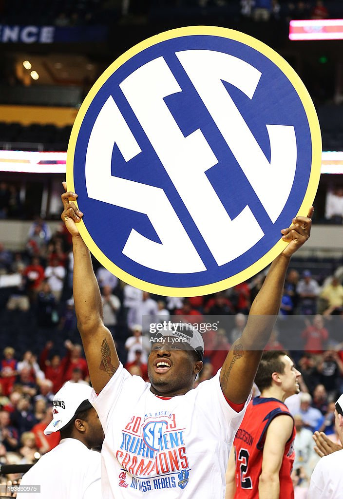 Jarvis Summers #32 of the Ole Miss Rebels celebrates their 66 to 63 win over the Florida Gators in the SEC Basketball Tournament Championship game at Bridgestone Arena on March 17, 2013 in Nashville, Tennessee.