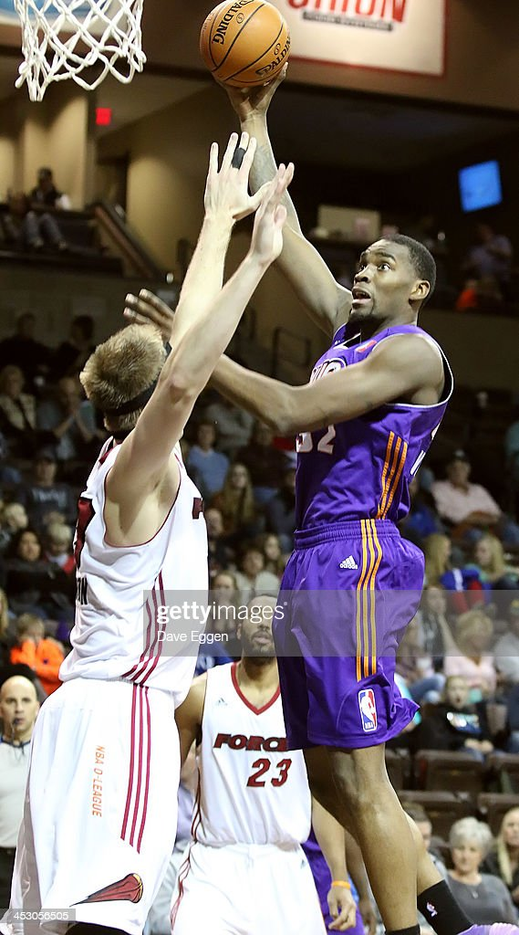 Jarvis Varnado from the Iowa Energy shoots a short hook over Justin Hamilton from the Sioux Falls Skyforce in their NBA DLeague game November 30 2013...