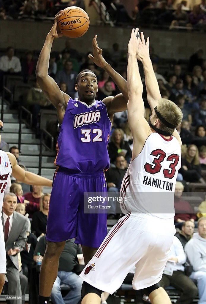 Jarvis Varnado from the Iowa Energy shoots against Justin Hamilton from the Sioux Falls Skyforce in their NBA DLeague game November 30 2013 at the...