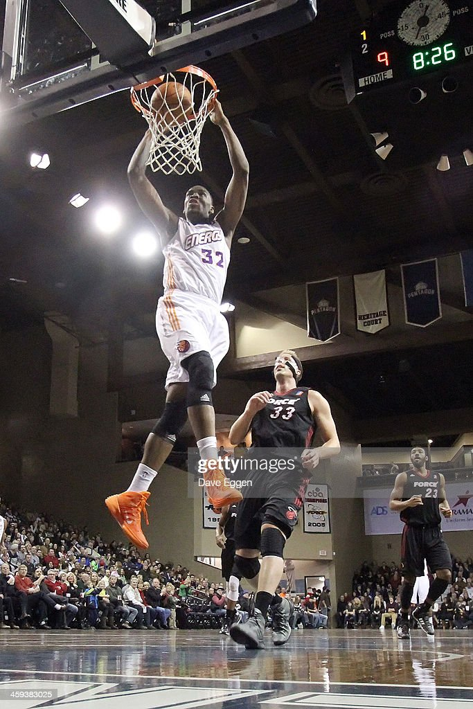Jarvis Varnado from the Iowa Energy slams home two points past Justin Hamilton from the Sioux Falls Skyforce in the first half of their NBA DLeague...