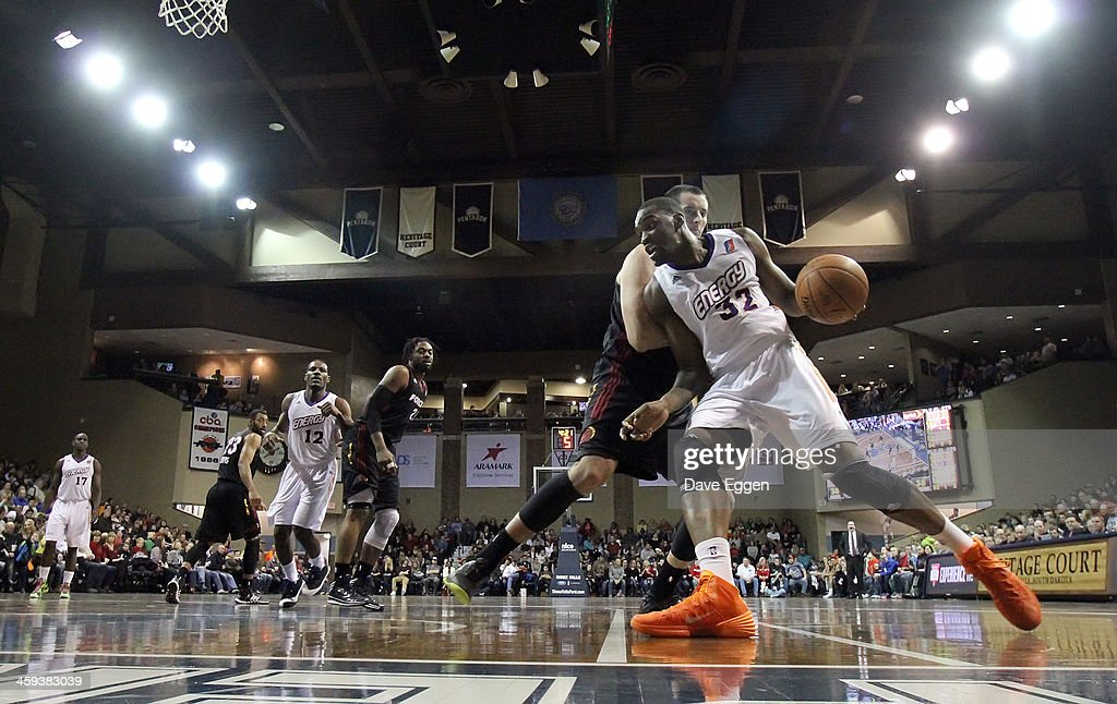 Jarvis Varnado from the Iowa Energy tries to drive against Chris Ayer from the Sioux Falls Skyforce in the first half of their NBA DLeague game...