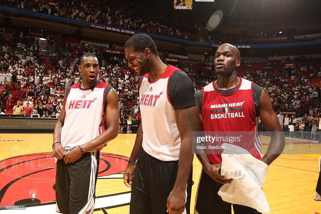 Jarvis Varnado Joel Anthony and Greg Oden of the Miami Heat share a laugh after the Red White scrimmage game on October 6 2013 at American Airlines...