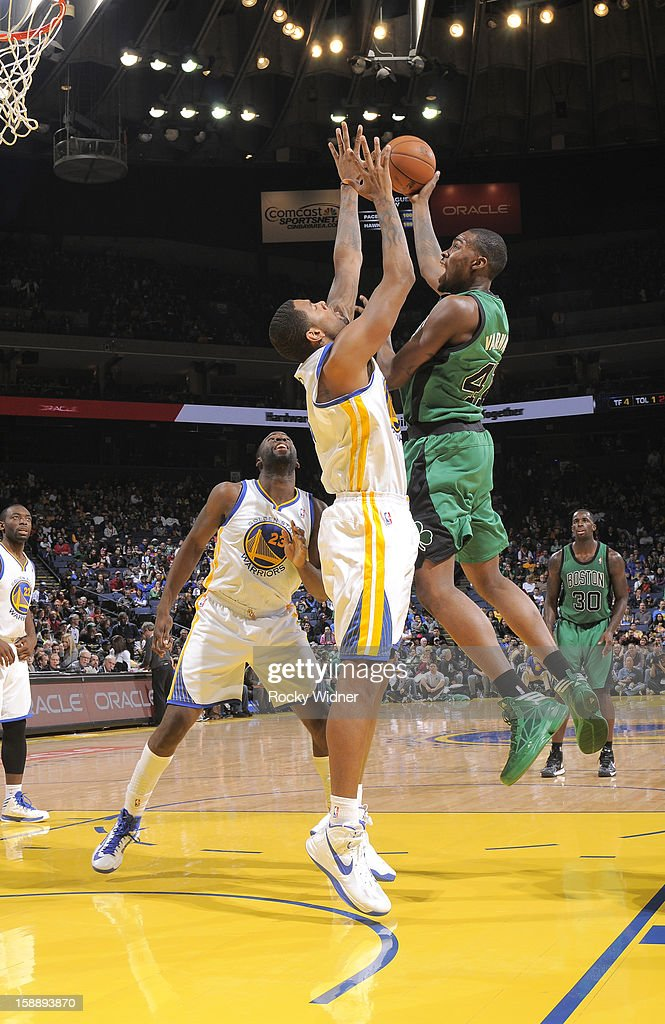 Jarvis Varnado #41 of the Boston Celtics shoots against Jeremy Tyler #3 of the Golden State Warriors on December 29, 2012 at Oracle Arena in Oakland, California.