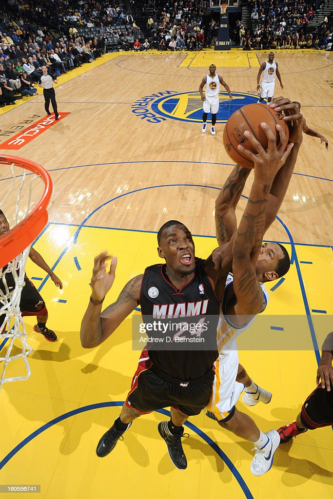 <a gi-track='captionPersonalityLinkClicked' href=/galleries/search?phrase=Jarvis+Varnado&family=editorial&specificpeople=4186391 ng-click='$event.stopPropagation()'>Jarvis Varnado</a> #24 of the Miami Heat goes up for a rebound against <a gi-track='captionPersonalityLinkClicked' href=/galleries/search?phrase=Jeremy+Tyler&family=editorial&specificpeople=5440865 ng-click='$event.stopPropagation()'>Jeremy Tyler</a> #3 of the Golden State Warriors on January 16, 2013 at Oracle Arena in Oakland, California.