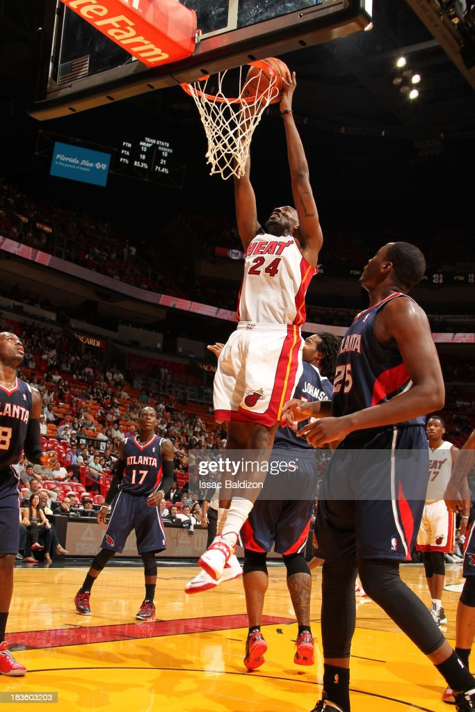 Jarvis Varnado of the Miami Heat goes up for the dunk against the Atlanta Hawks during a game on October 7 2013 at American Airlines Arena in Miami...