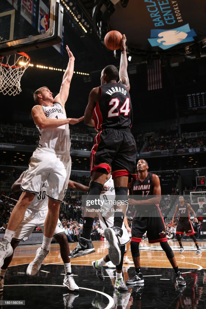 Jarvis Varnado of the Miami Heat shoots against Mason Plumlee of the Brooklyn Nets during a preseason game at the Barclays Center on October 17 2013...