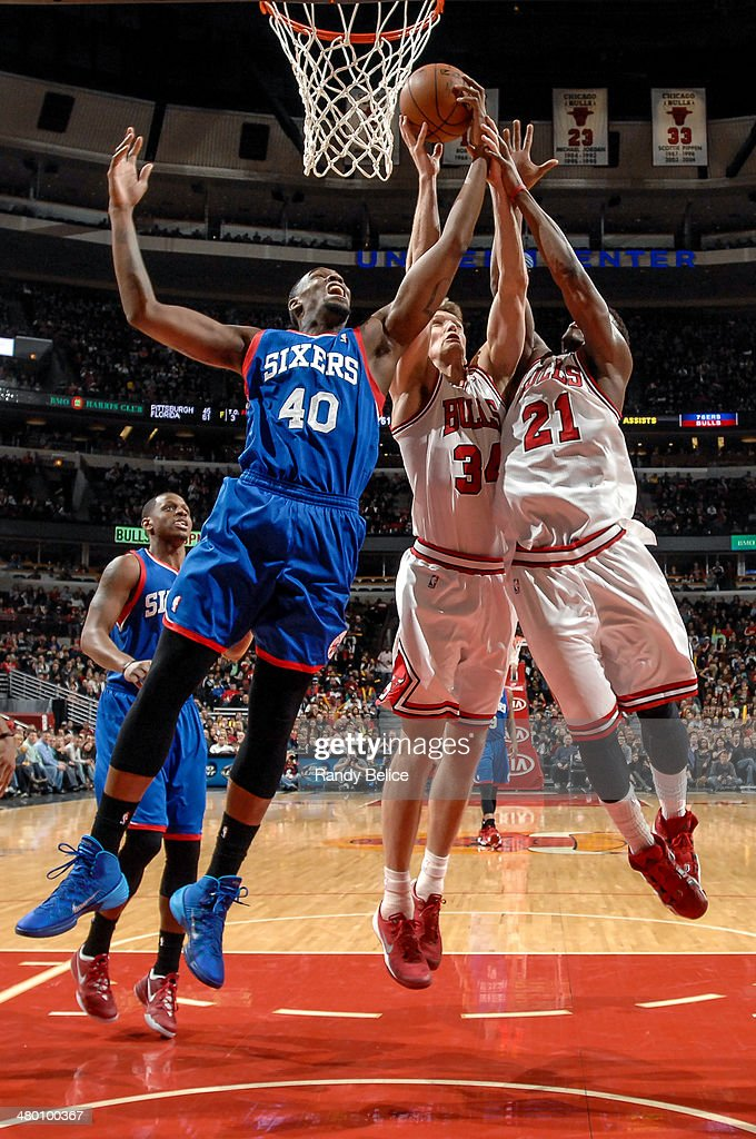 Jarvis Varnado of the Philadelphia 76ers battles for the rebound against Mike Dunleavy and Jimmy Butler of the Chicago Bulls on March 22 2013 at the...