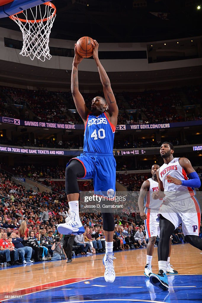 Jarvis Varnado of the Philadelphia 76ers goes up for a dunk against the Detroit Pistons at the Wells Fargo Center on March 29 2014 in Philadelphia...