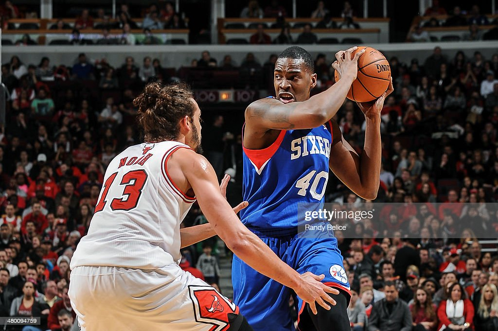 Jarvis Varnado of the Philadelphia 76ers handles the ball against Joakim Noah of the Chicago Bulls on March 22 2013 at the United Center in Chicago...