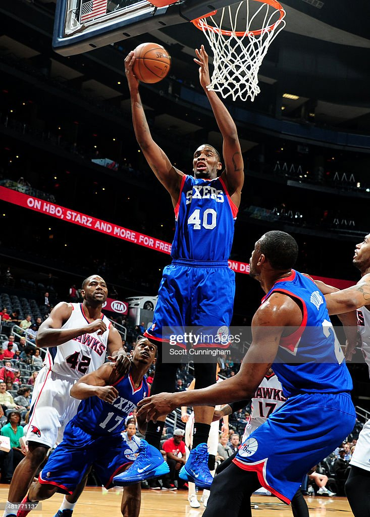 Jarvis Varnado of the Philadelphia 76ers rebounds against the Atlanta Hawks on March 31 2014 at Philips Arena in Atlanta Georgia NOTE TO USER User...