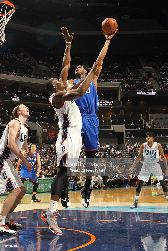 Jarvis Varnado of the Philadelphia 76ers shoots against the Charlotte Bobcats during the game at the Time Warner Cable Arena on April 12 2014 in...