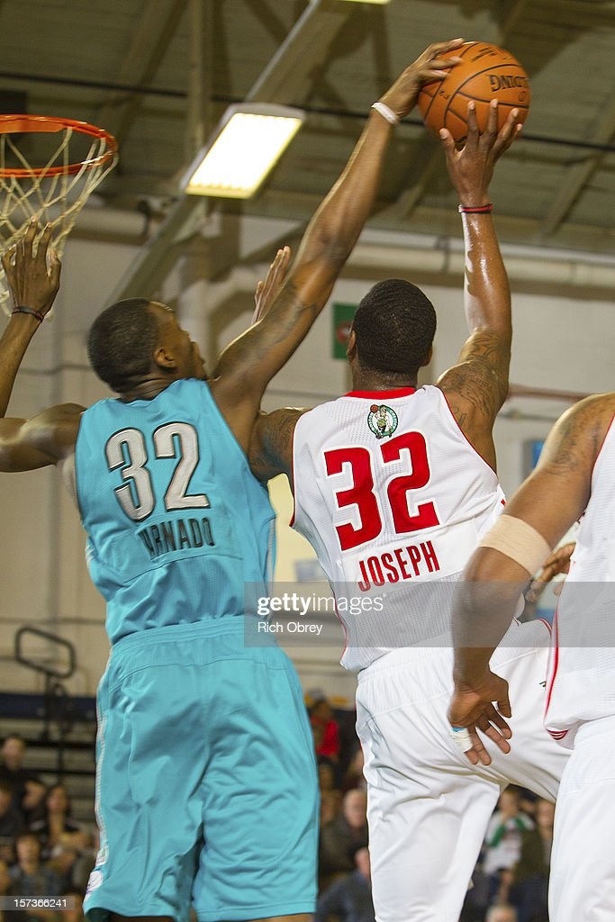 Jarvis Varnado of the Sioux Falls Skyforce rejects a shot attempt by Kris Joseph of the Maine Red Claws on December 2 2012 at the Portland Expo in...