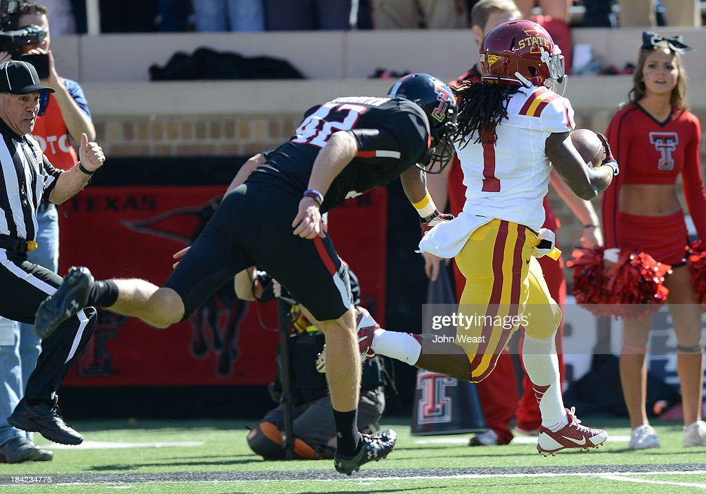 Jarvis West #1 of the Iowa State Cyclones returns a kick off for touchdown against the Texas Tech Red Raiders during first quarter action on October 12, 2013 at AT&T Jones Stadium in Lubbock, Texas. Texas Tech won the game over Iowa State 42-35.
