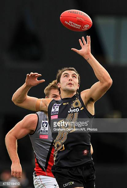 Jaryd Cachia of the Tigers controls the ball during the round seven VFL match between the Richmond Tigers and the Essendon Bombers at Punt Road Oval...
