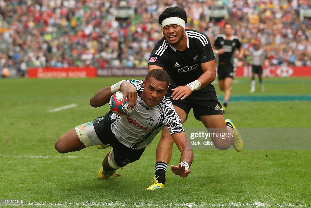 Jasa Veremalua of Fiji dives over to a try during the cup semi final match between Fiji and New Zealand during day three of the 2013 Hong Kong Sevens at Hong Kong Stadium on March 24, 2013 in So Kon Po, Hong Kong.