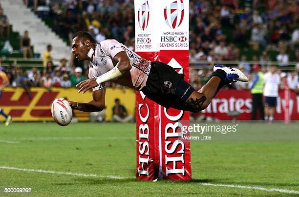 Jasa Veremalua of Fiji scores a try against England in the Cup Final during the Emirates Dubai Rugby Sevens HSBC World Rugby Sevens Series at The...