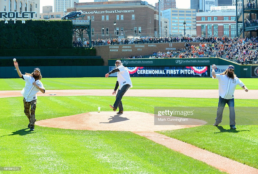 Jase, Si and Willie Robertson (L-R) of Cable TV's 'Duck Dynasty' throw out the ceremonial first pitches prior to the game between the Detroit Tigers and the Chicago White Sox at Comerica Park on September 22, 2013 in Detroit, Michigan. The White Sox defeated the Tigers 6-3.