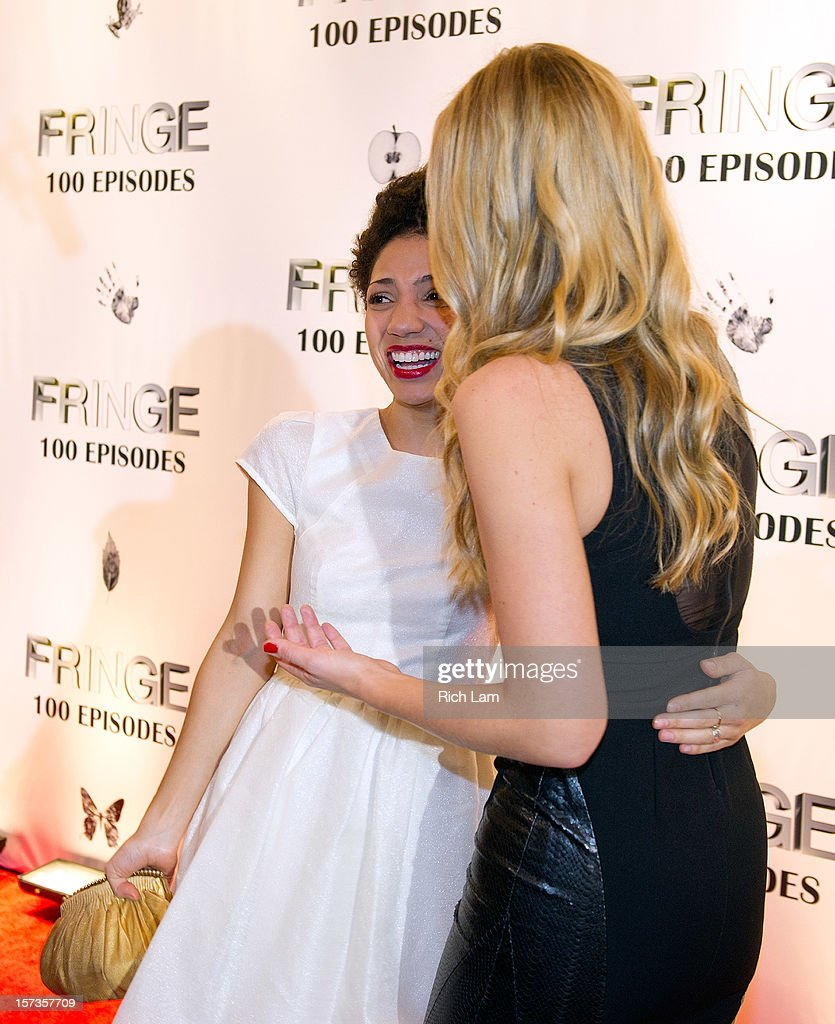 Jasika Nicole (L) and Anna Torv share a laugh on the red carpet while attending 'Fringe' celebrates 100 episodes and final season at Fairmont Pacific Rim on December 1, 2012 in Vancouver, Canada.