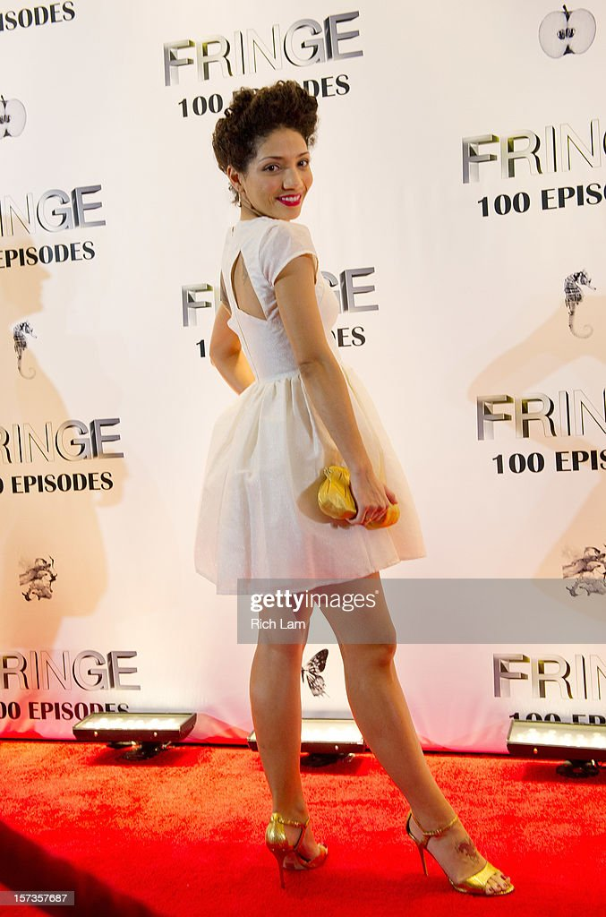 Jasika Nicole poses for a photo on the red carpet while attending 'Fringe' celebrates 100 episodes and final season at Fairmont Pacific Rim on December 1, 2012 in Vancouver, Canada.