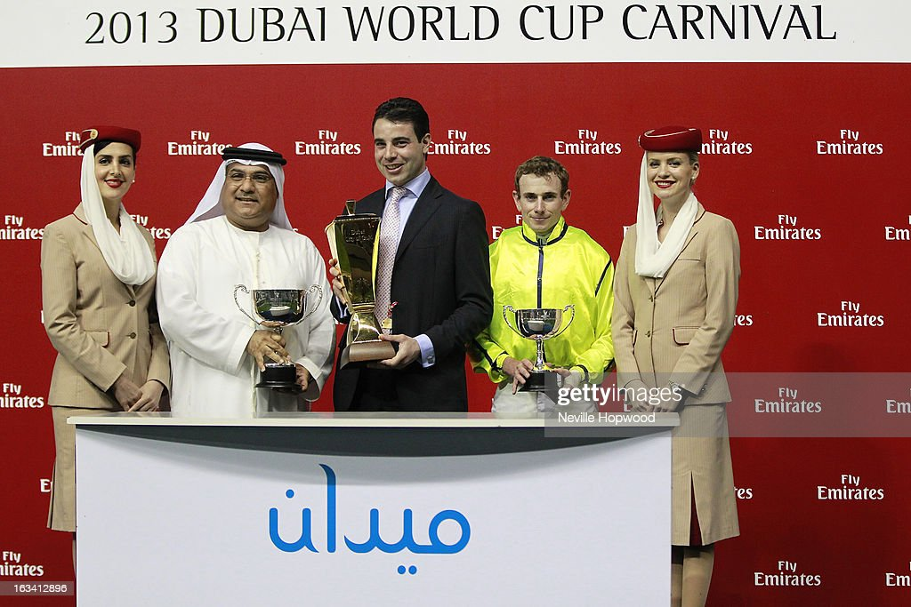 Jasim Saif, Vice President of Emirates SkyCargo, Trainer Marco Botti and Jockey Ryan Moore attend the Jakkalberry presentation for winning the Group 2 Dubai City Of Gold during Super Saturday at Meydan Racecourse on March 9, 2013 in Dubai, United Arab Emirates.