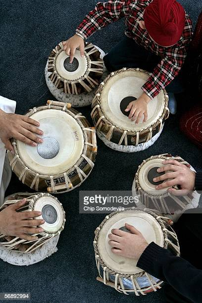 Jasjot Singh and Kulvir Singh practice playing the traditonal tabla hand drums during music lessons at the new National Gurdwara or house of God and...