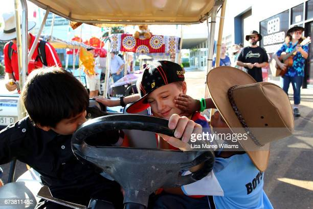 Jasmeet Singhusa Joseph Doody and Rathamile Radebe test out a float on Peel Street during the Tamworth Country Music Festival Cavalcade on January 28...