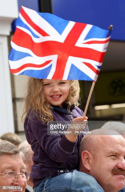 Jasmin Dickie from Huntingdon waves the Union flag during a parade by The 1st Battalion The Royal Anglian Regiment as they march through the centre...