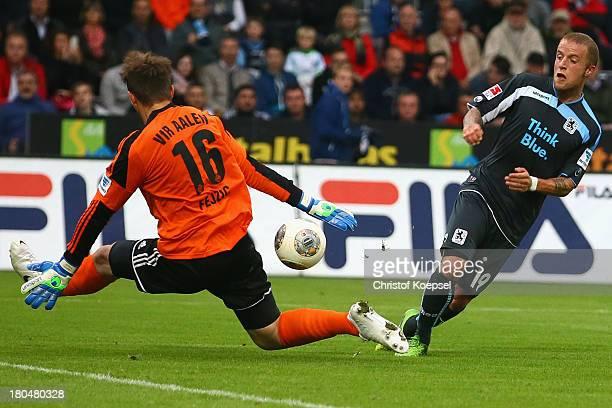Jasmin Fejzic of Aalen saves against Daniel Adlung of Muenchen during the Second Bundesliga match between VfR Aalen and 1860 Muenche at ScholzArena...