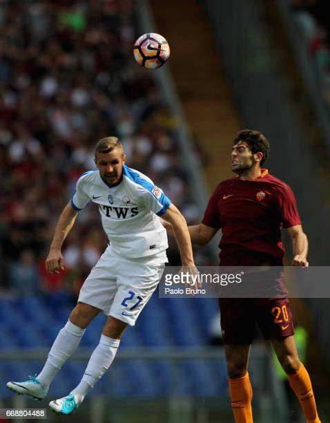 Jasmin Kurtic of Atalanta BC competes for the ball with Federico Fazio of AS Roma during the Serie A match between AS Roma and Atalanta BC at Stadio...