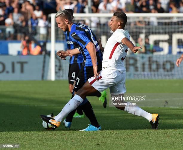 Jasmin Kurtic of Atalanta BC competes for the ball with Juan Jesus of AS Roma during the Serie A match between Atalanta BC and AS Roma at Stadio...