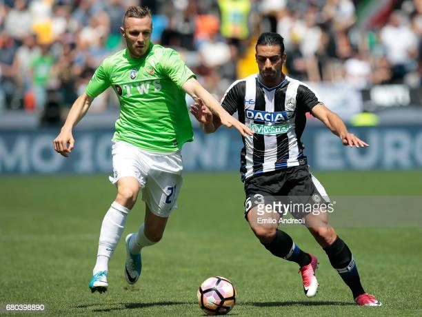 Jasmin Kurtic of Atalanta BC competes for the ball with Kadhim Ali Adnan of Udinese Calcio during the Serie A match between Udinese Calcio and...