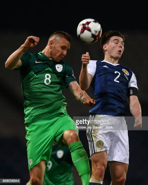 Jasmin Kurtic of Slovenia and Kieran Tierney of Scotland during the FIFA 2018 World Cup Qualifier between Scotland and Slovenia at Hampden Park on...