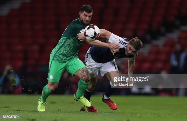 Jasmin Kurtic of Slovenia battles with James Forrest of Scotland during the FIFA 2018 World Cup Qualifier between Scotland and Slovenia at Hampden...