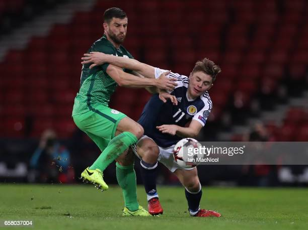 Jasmin Kurtic of Slovenia vies with James Forrest of Scotland battle for the ball during the FIFA 2018 World Cup Qualifier between Scotland and...