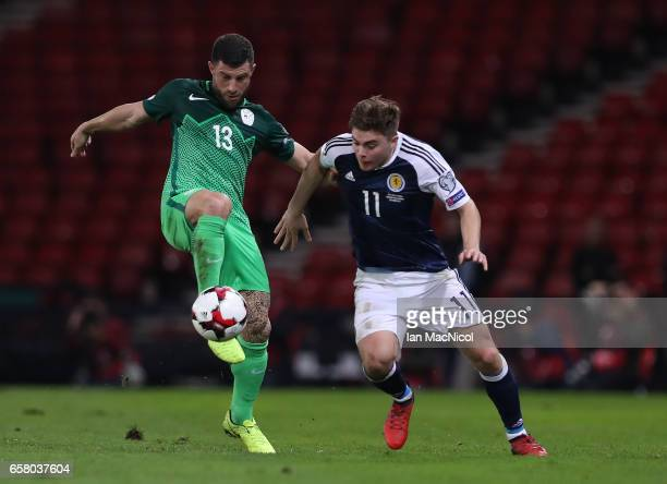 Jasmin Kurtic of Slovenia vies with James Forrest of Scotland during the FIFA 2018 World Cup Qualifier between Scotland and Slovenia at Hampden Park...