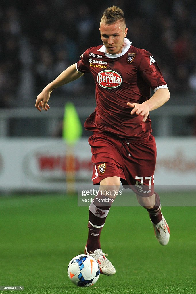 <a gi-track='captionPersonalityLinkClicked' href=/galleries/search?phrase=Jasmin+Kurtic&family=editorial&specificpeople=7418994 ng-click='$event.stopPropagation()'>Jasmin Kurtic</a> of Torino FC in action during the Serie A match between Torino FC and AS Livorno Calcio at Stadio Olimpico di Torino on March 22, 2014 in Turin, Italy.