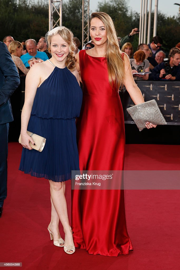 Jasmin Schwiers and Laura Osswald attend the red carpet of the Deutscher Fernsehpreis 2014 on October 02, 2014 in Cologne, Germany.