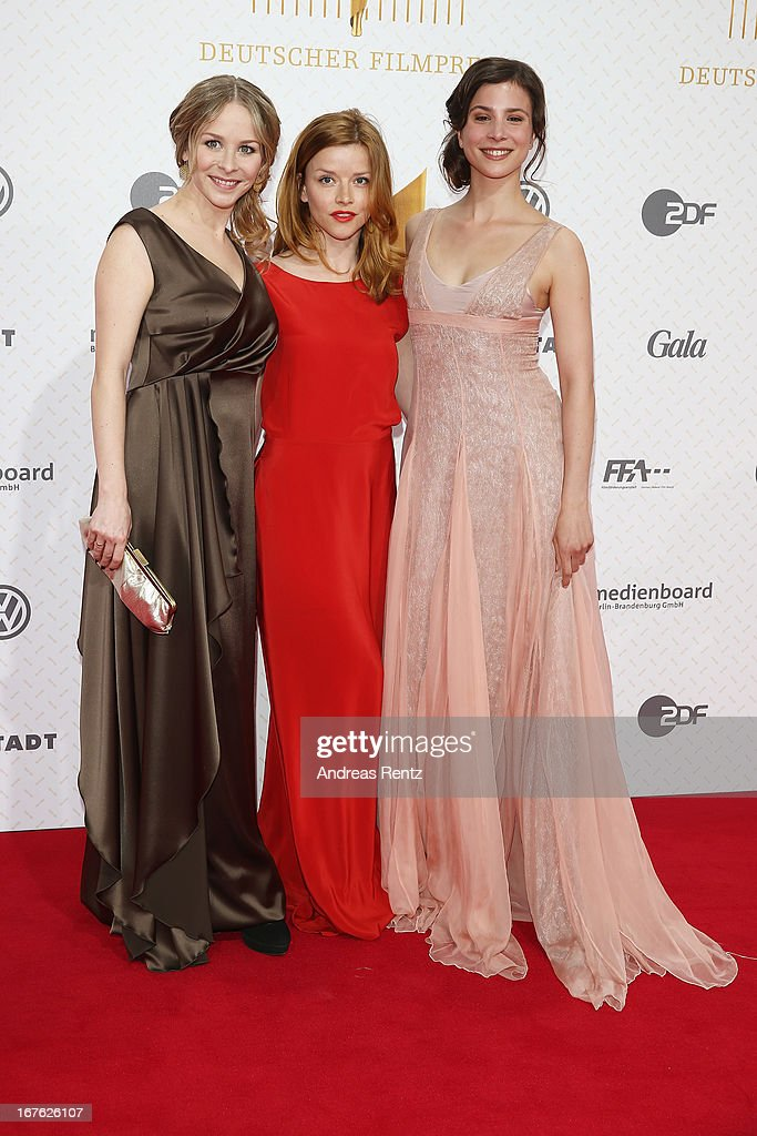 Jasmin Schwiers, Karoline Schuch and Aylin Tezel arrive for the Lola - German Film Award 2013 at Friedrichstadt-Palast on April 26, 2013 in Berlin, Germany.
