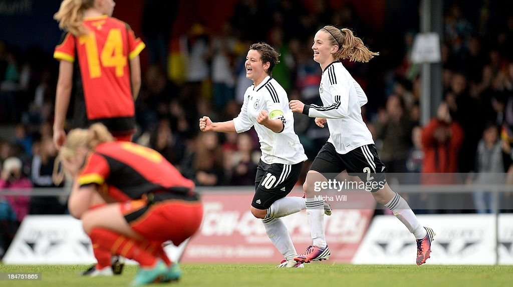 Jasmin Sehan (2nd R) of Germany celebrates with Michaela Brandenburg (R) after scoring the opening/first goal during the U17 Girls Euro Qualifier match between Germany and Belgium at Bioenergie-Arena on October 16, 2013 in Grossbardorf, Germany.